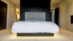 A floating bed with under lights