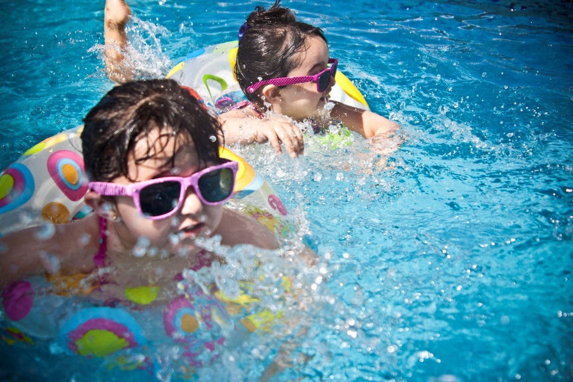 Kids out of school swimming