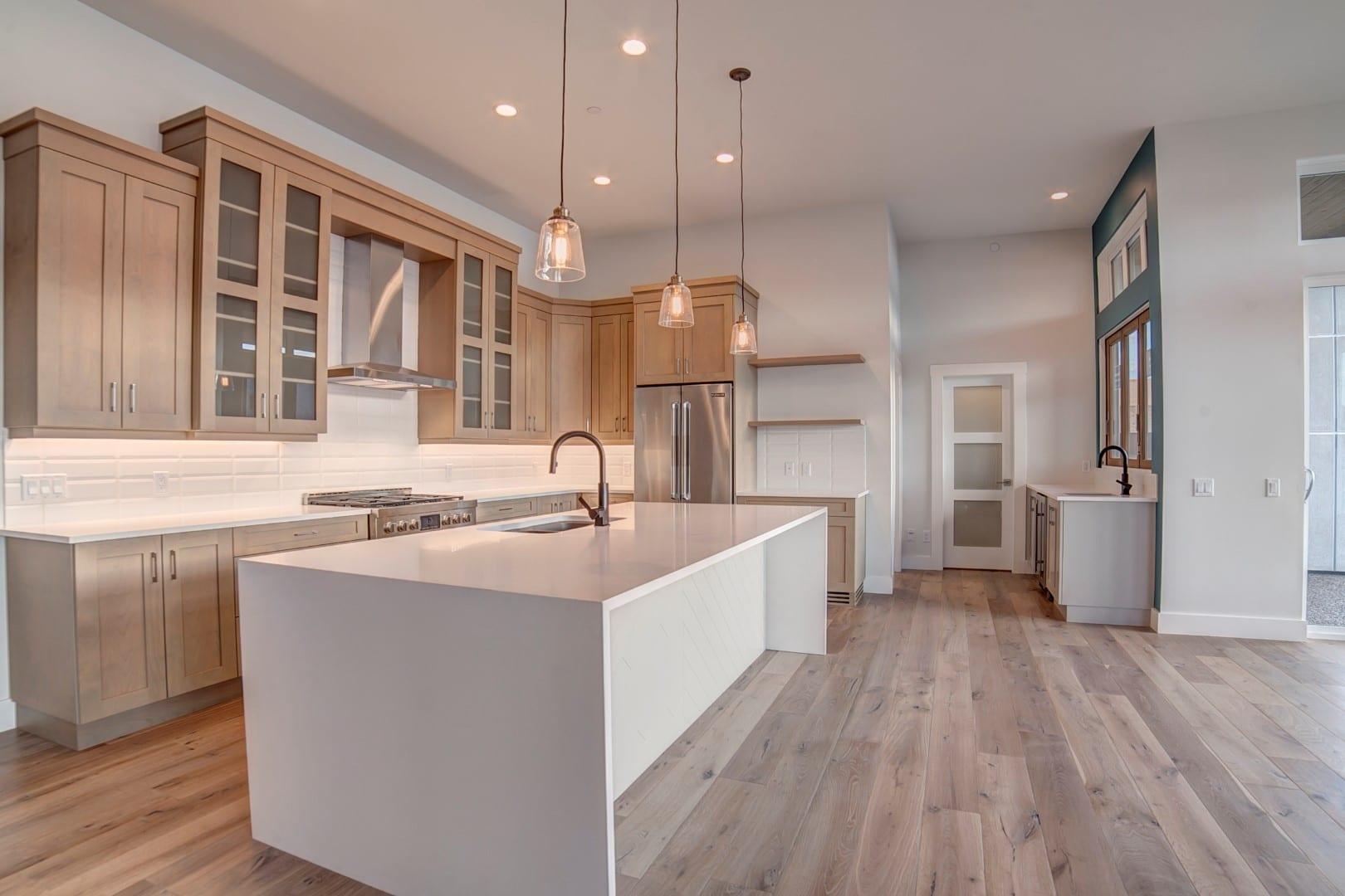 Mckinley beach show home kitchen rykon construction for Kitchen cabinets kelowna
