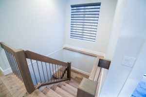 Hardwood stairwell McKinley Beach – Custom Home
